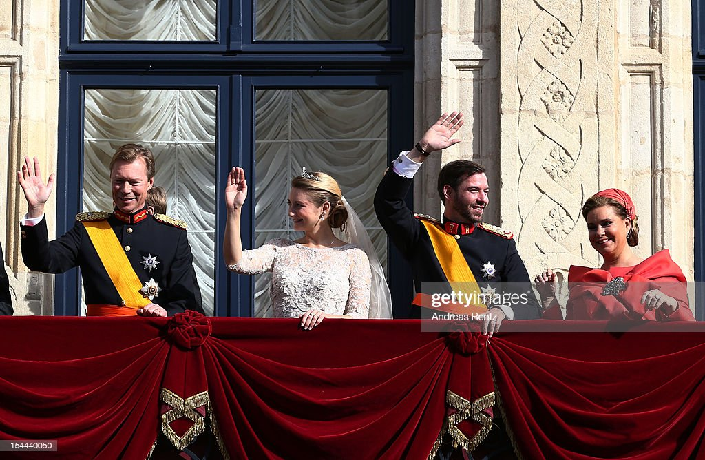 Grand Duke Henri of Luxembourg, Princess Stephanie of Luxembourg, Prince Guillaume Of Luxembourg and Grand Duchess Maria Teresa of Luxembourg wave to the crowds from the balcony of the Grand-Ducal Palace the wedding ceremony of Prince Guillaume Of Luxembourg and Princess Stephanie of Luxembourg at the Cathedral of our Lady of Luxembourg on October 20, 2012 in Luxembourg, Luxembourg. The 30-year-old hereditary Grand Duke of Luxembourg is the last hereditary Prince in Europe to get married, marrying his 28-year old Belgian Countess bride in a lavish 2-day ceremony.