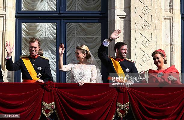 Grand Duke Henri of Luxembourg Princess Stephanie of Luxembourg Prince Guillaume Of Luxembourg and Grand Duchess Maria Teresa of Luxembourg wave to...