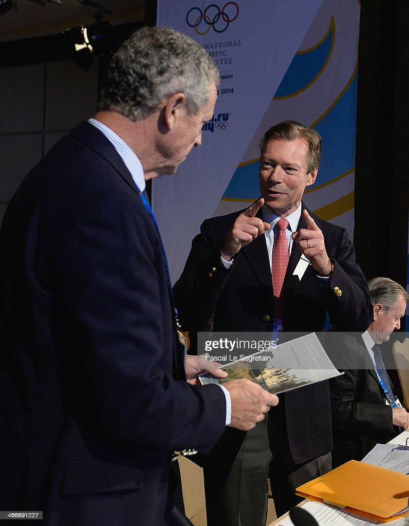 Grand Duke Henri of Luxembourg talks to Guy Drut of France as they attend the International Olympic Committee meeting ahead of the Sochi 2014 Winter...
