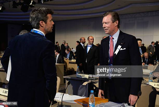 Grand Duke Henri of Luxembourg talks to Prince Frederik of Denmark as they attend the International Olympic Committee meeting ahead of the Sochi 2014...