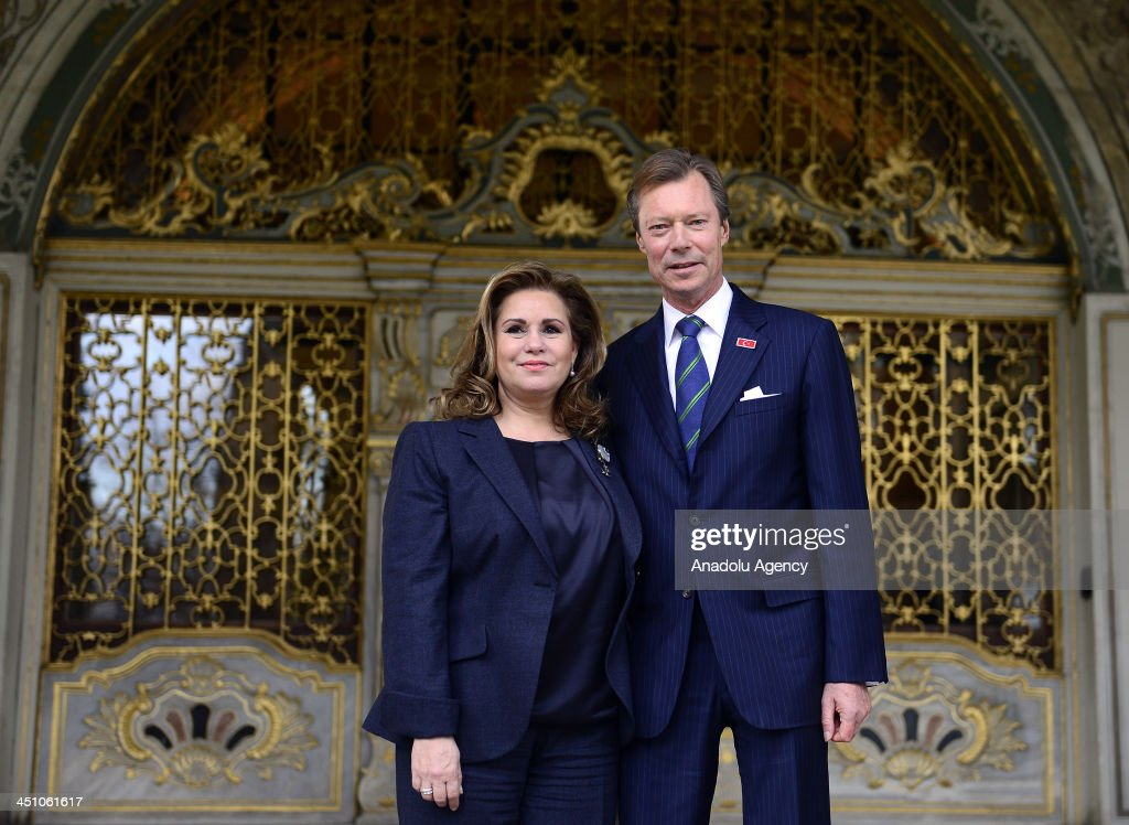 Grand Duke of Luxembourg, Henri (R) and Grand Duchess of Luxembourg, Maria Teresa (L) pose for a photograph during their visit to Topkapi Palace on November 21, 2013 in Istanbul, Turkey.