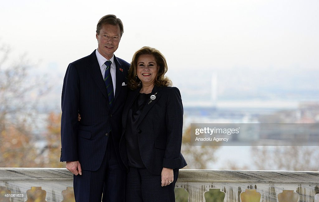Grand Duke of Luxembourg, Henri (L) and Grand Duchess of Luxembourg, Maria Teresa (R) pose for a photograph during their visit to Topkapi Palace on November 21, 2013 in Istanbul, Turkey.