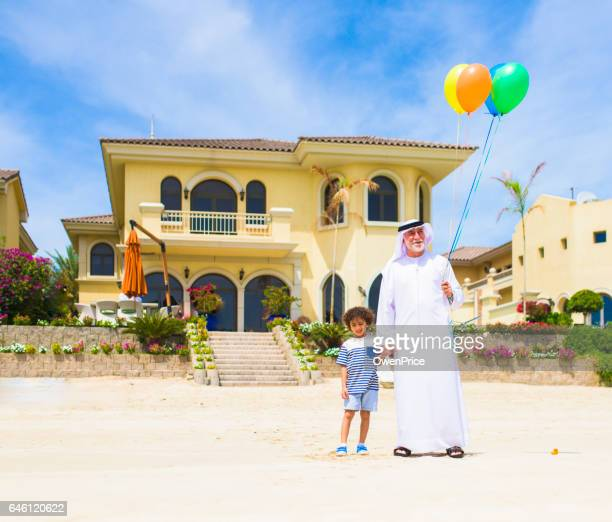 Grand Father and son with balloons on the beach