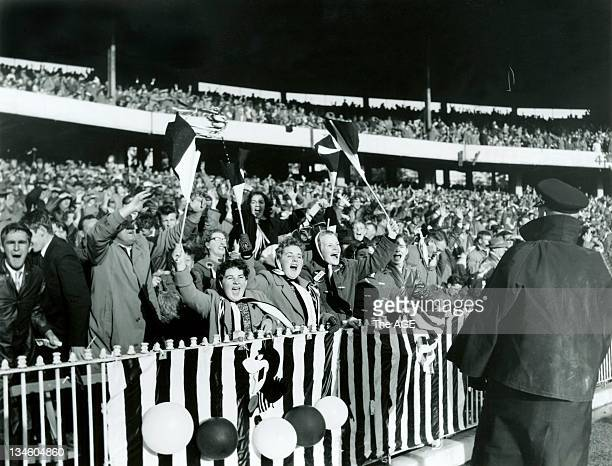 VFL Grand Final 1958 Collingwood v Melbourne Collingwood fans cheer and wave flags during the match at the MCG 20 September 1958