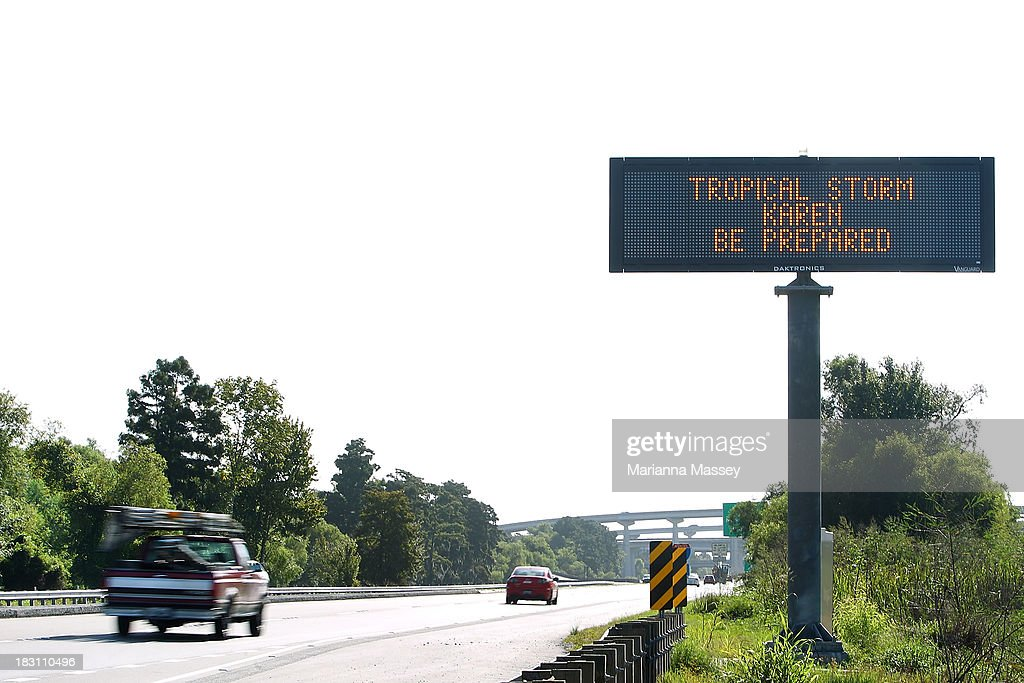 A highway sign alerts residents ahead of Tropical Storm Karen on October 4, 2013 in Grand Isle, Louisiana. Louisiana authorities issued a mandatory evacuation of low-lying areas even as Tropical Storm Karen weakened while moving through the Gulf of Mexico.