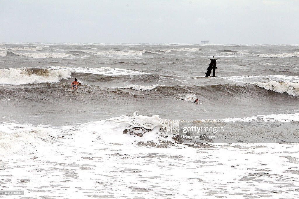 Surfers William Rhodes and Jordan Besso brave the rough waters of the Grand Isle pass as winds pick up ahead of Tropical Storm Karen on October 4, 2013 in Grand Isle, Louisiana. Louisiana authorities issued a mandatory evacuation of low-lying areas even as Tropical Storm Karen weakened while moving through the Gulf of Mexico.