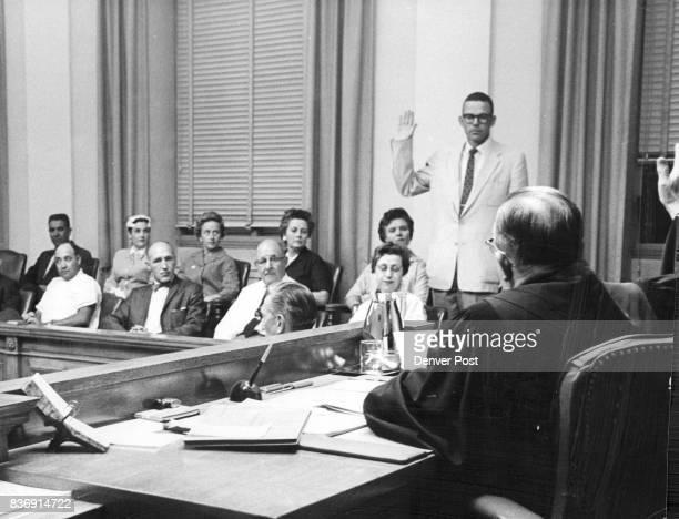 Grand Jury Foreman takes his oath are front row Guy Leland Reed Jr Gordon E Phifer Cayetano Perez Robert A McCune DeWayne McCord and Mrs Thelma M...