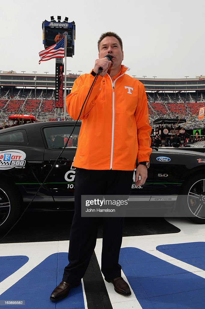 Grand Marshal Butch Jones, Head Football Coach, University of Tennessee gives the command for Drivers to start their engines prior to the NASCAR Sprint Cup Series Food City 500 at Bristol Motor Speedway on March 17, 2013 in Bristol, Tennessee.