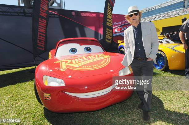 Grand Marshal Owen Wilson voice of Lightning McQueen in 'Cars 3' poses with Lightning McQueen for the 59th Annual DAYTONA 500 at Daytona...