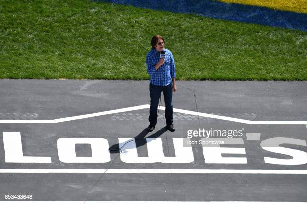 Grand Marshall John Fogerty says 'Drivers start your engines' during the Kobalt 400 NASCAR Monster Energy Cup Series race on March 12 2017 at Las...