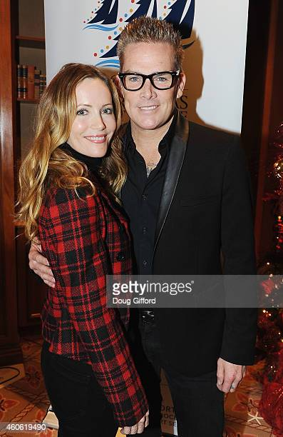Grand Marshals Leslie Mann and Mark McGrath pose before the start of the 106th Newport Beach Christmas Boat Parade at The Balboa Bay Club And Resort...