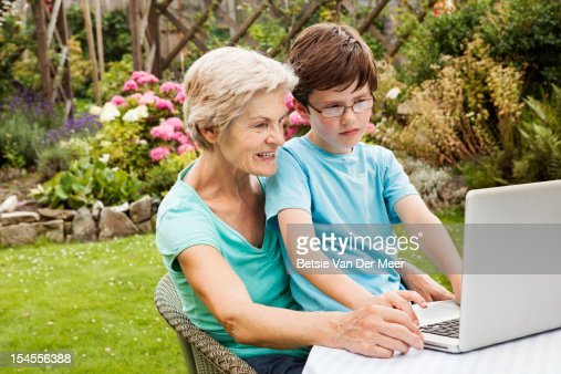 Grand mother and grandchild using laptop. : Bildbanksbilder