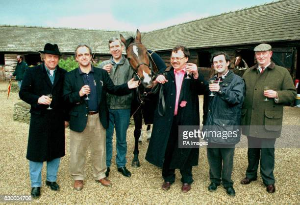 Grand National winner Earth Summit at home in Naunton Gloucester today with owners Ricky George Peter Earle Bob Sims Nigel Payne Mike Bailey and...