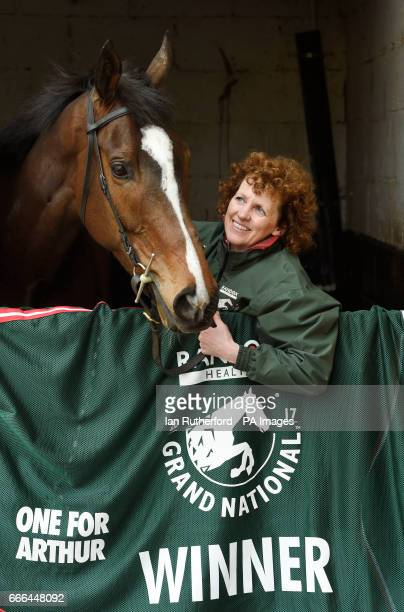 Grand National winner One For Arthur pictured with Lucinda Russell at her yard in Kinross Scotland