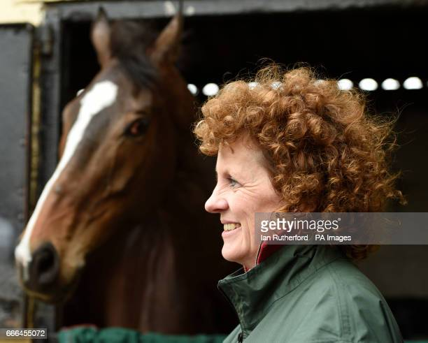 Grand National winner One For Arthur pictured with Lucinda Russell at trainer Russell's yard in Kinross Scotland
