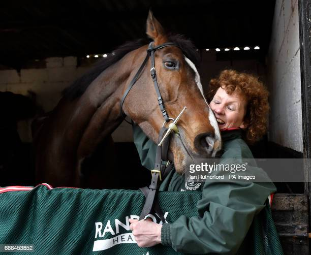 Grand National winner One For Arthur pictured with trainer Lucinda Russell at her yard in Kinross Scotland
