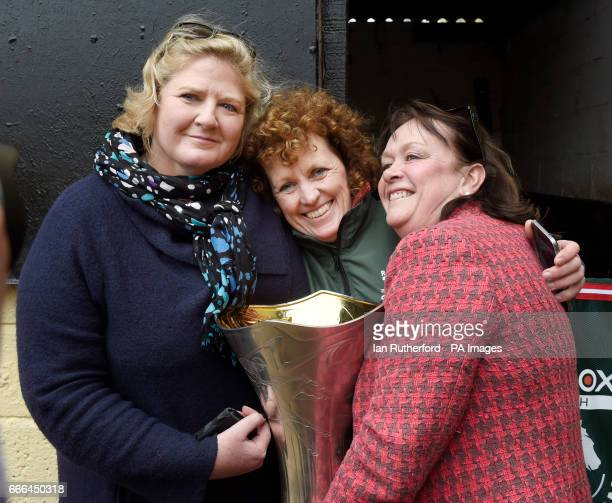 Grand National winner One For Arthur's owners Balinda McClung and Debbs Thomson hug trainer Balinda Russell at Russell's yard in Kinross Scotland