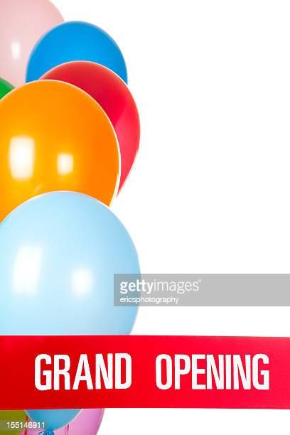 Grand opening ribbon and ballons on white background