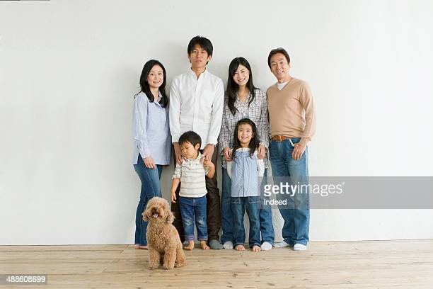 Grand parents and young parents and kids who make pose