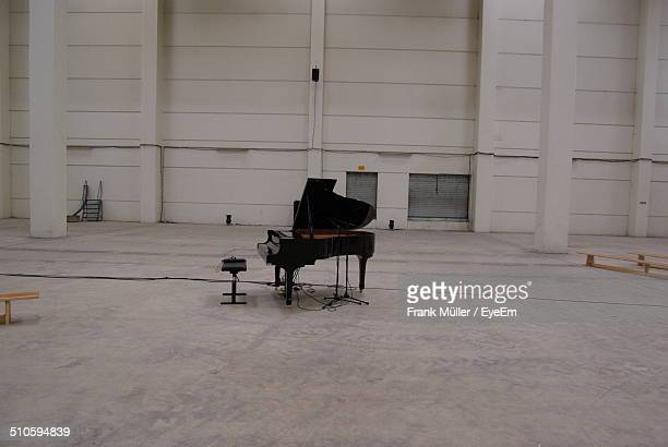Grand piano in spacious empty hall