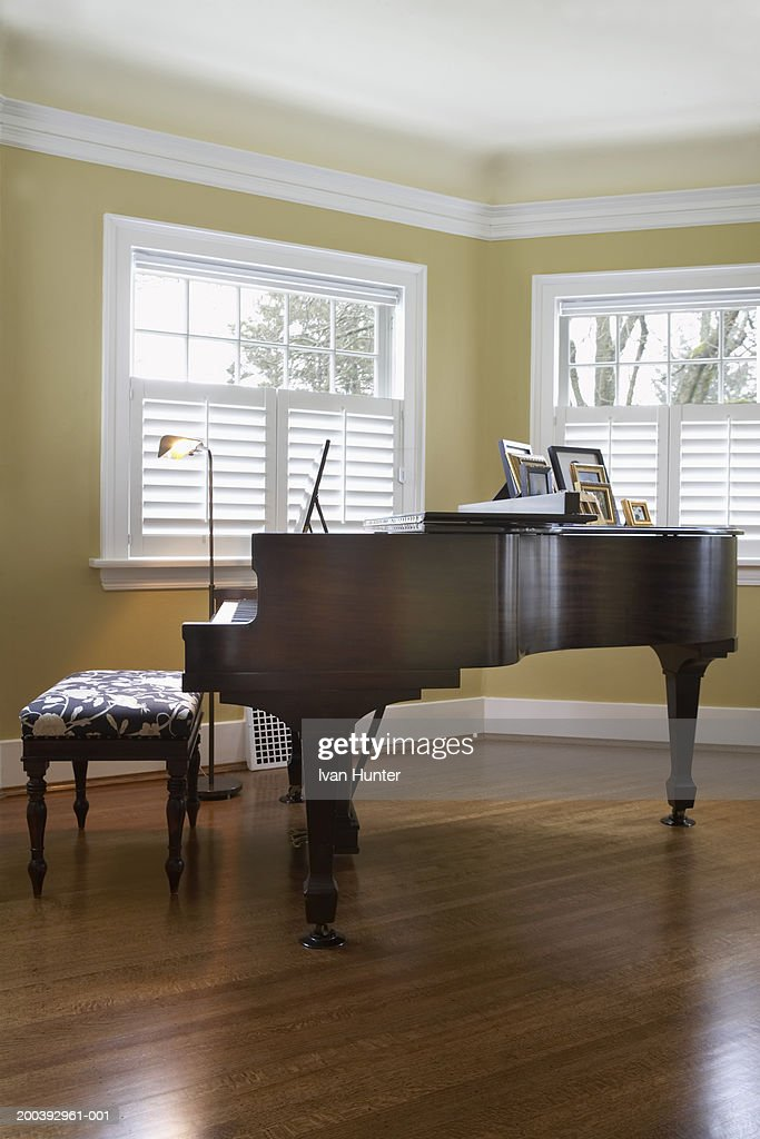 Grand piano on hardwood floors in living room stock photo for Grand piano in living room