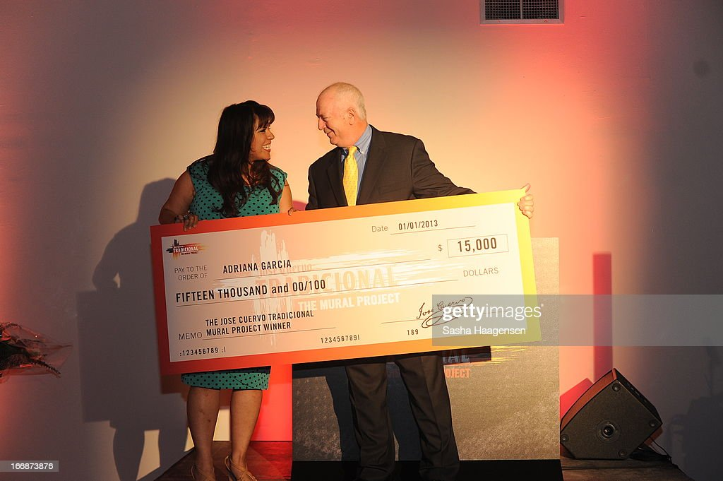 Grand Prize Winner, Adriana Garcia, accepts her check from John Hartrey of Diageo during the Jose Cuervo Grand Prize Winner Annoucement party at Centro Cultural Aztlan on April 17, 2013 in San Antonio, Texas.