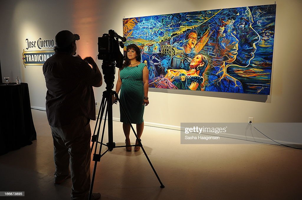 Grand Prize Winner, Adriana Garcia, being interviewed by reporters during the Jose Cuervo Grand Prize Winner Annoucement party at Centro Cultural Aztlan on April 17, 2013 in San Antonio, Texas.