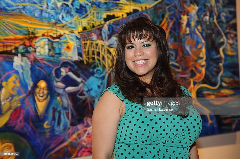 Grand Prize Winner, Adriana Garcia, in front of her mural during the Jose Cuervo Grand Prize Winner Annoucement party at Centro Cultural Aztlan on April 17, 2013 in San Antonio, Texas.
