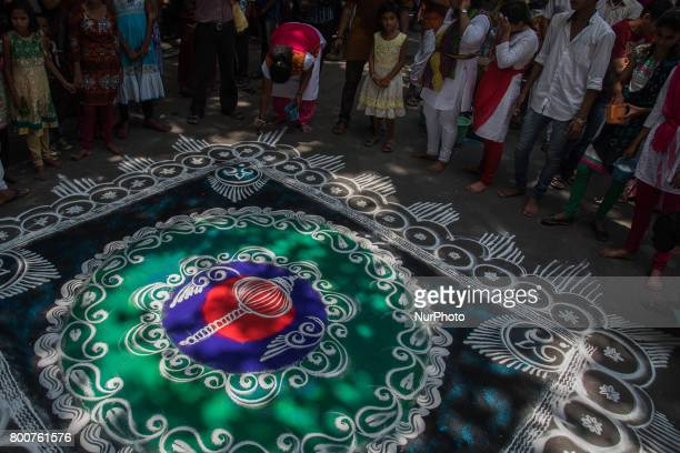 A grand rangoli has been drawn on the road in occasion of Iskon rathyatra in Kolkata India on 2562017 Rath Yatra or the cart festival is more than...