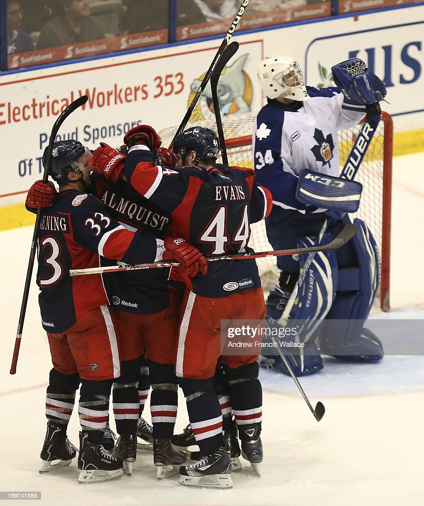 Grand Rapids Griffins Luke Glendening (33) celebrates his game-winning goal with teammates in front of Toronto Marlies goalie Drew MacIntyre (34)) during third period action in Game 6 of the AHL Western Conference semifinals. The Griffins defeated the Marlies 4-3 to win the best-of-seven series.