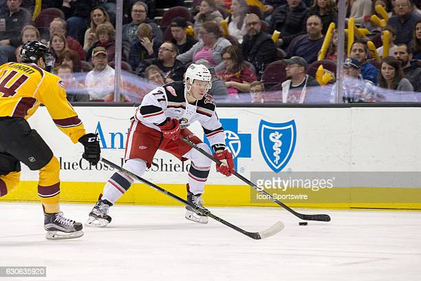Grand Rapids Griffins RW Evgeny Svechnikov is defended by Cleveland Monsters D Dean Kukan during the first period of the AHL hockey game between the...