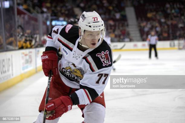 Grand Rapids Griffins RW Evgeny Svechnikov plays the puck during the first period of the AHL hockey game between the Grand Rapids Griffins and...