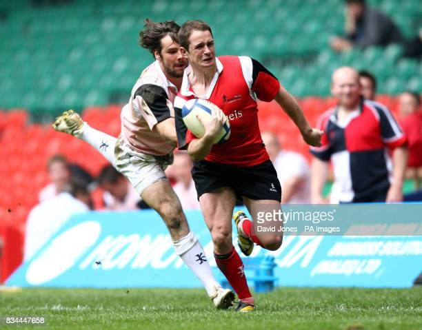 Grand Slammers' Shane Williams is caught by World Legends' Ben Foden during the Shane Williams Testimonial match at the Millennium Stadium Cardiff