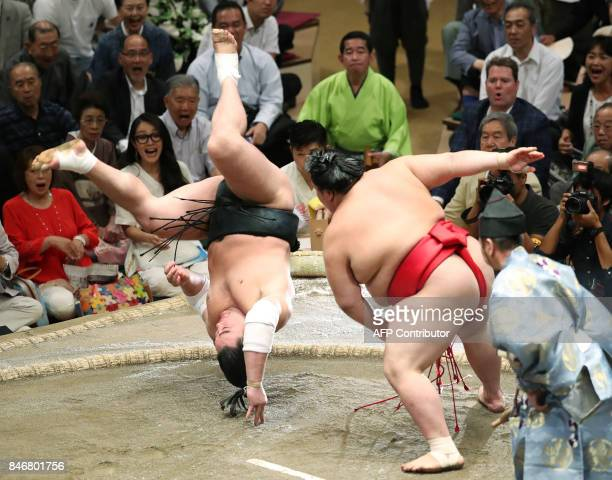 TOPSHOT Grand sumo champion or 'yokozuna' Harumafuji of Mongolia somersaults over to lose his bout against Onosho of Japan on the fifth day of the...