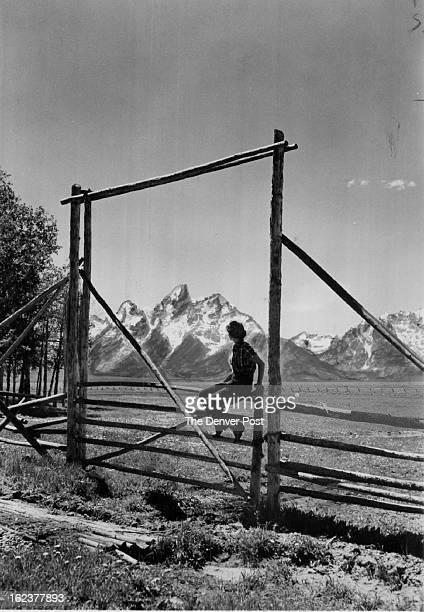 JUN 17 1951 Grand Teton Mtn's Wyo It's so easy to give a feeling of great depth to your scenic studies if you 'frame' some distant point through a...