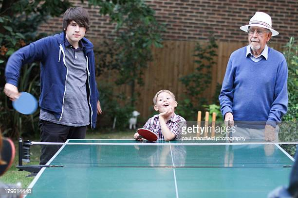 Grandad and grandsons playing table tennis