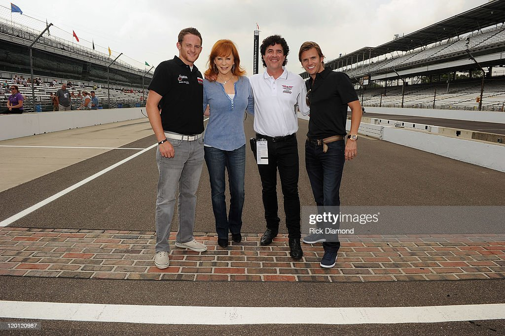 Grand-Am Continental Tire Challenge driver Shelby Blackstock, 2011 Indianapolis 500 winner Dan Wheldon, CEO and President of Big Machine Records Scott Borchetta and Reba McEntire arrive for the Brickyard 400 Qualifying presented by BigMachineRecords.com on July 30, 2011 in Indianapolis, Indiana.