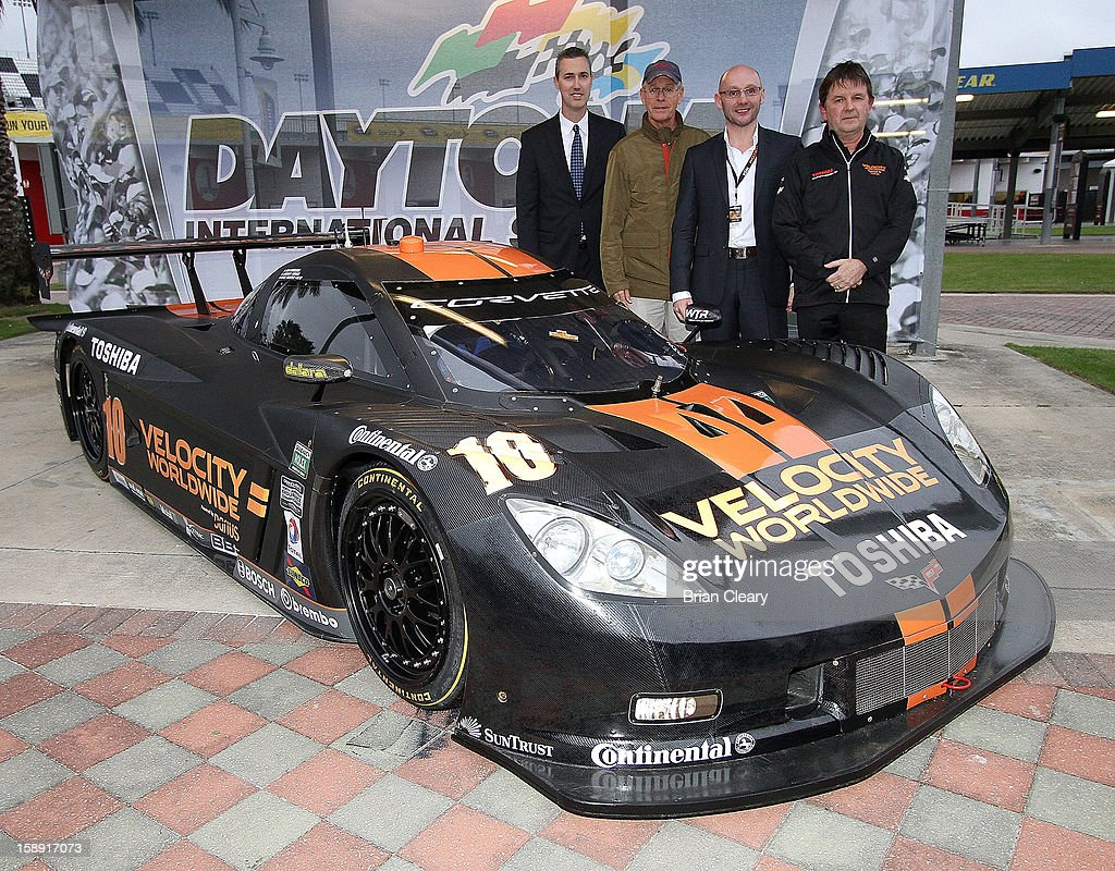 , Grand-Am President/CEO Ed Bennett, Grand-Am Founder Jim France, Velocity Worldwide CEO Americas Paul Blakely, and car onwer Wayne Taylor pose the #10 Wayne Taylor Racing Velocity Worldwide Corvette Dallara DP after a press conference announcing Velocity Worldwide as the team's new sponsor at Daytona International Speedway on January 3, 2013 in Daytona Beach, Florida.