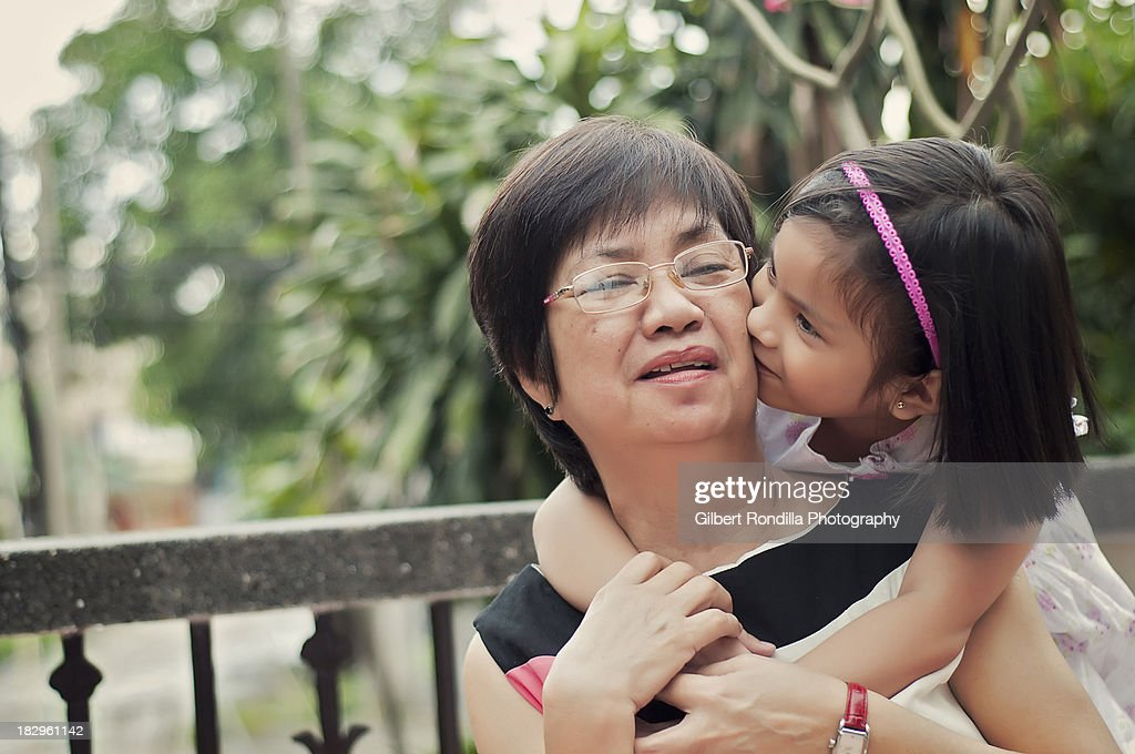 Grandaughter kissing grandmother