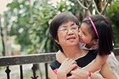 Grandaughter kissing grandmother