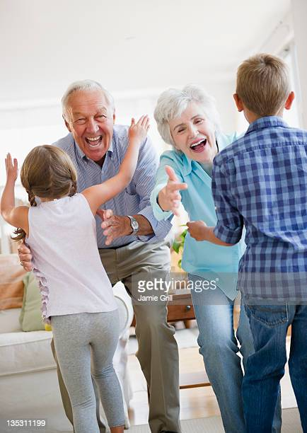 Grandchildren running to greet grandparents
