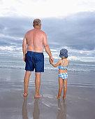 Granddad holding granddaughter's hand
