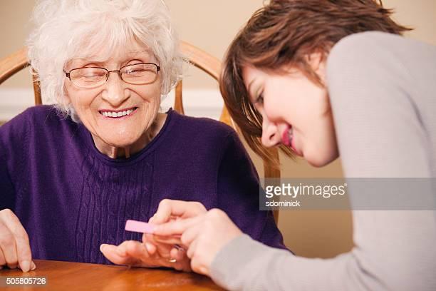 Granddaughter Filing Grandmother's Nails