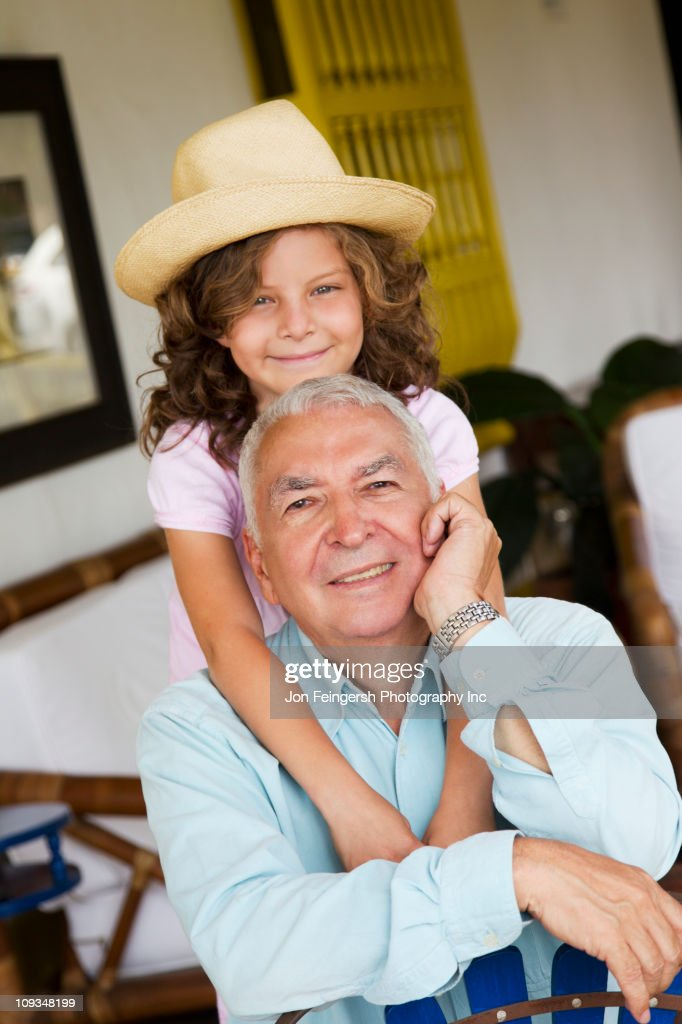 Granddaughter hugging grandfather : Stock Photo
