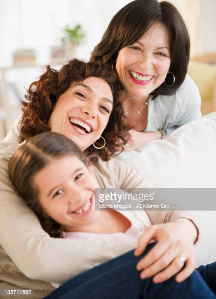 Granddaughter, mother and daughter hugging