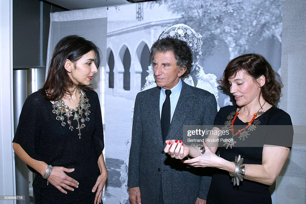 Granddaughter of Django Reinhardt, Pianist Charlotte Reinhardt, wearing jewelry of the collection, President of the 'Institut du Monde Arabe' <a gi-track='captionPersonalityLinkClicked' href=/galleries/search?phrase=Jack+Lang&family=editorial&specificpeople=220296 ng-click='$event.stopPropagation()'>Jack Lang</a> and Actress Elodie Mennegand, wearing jewelry of the collection, attend the Opening of the Exhibition 'Tresors à porter', Treasures to wear, presented in the Museum of the 'Institut du Monde Arabe' on February 11, 2016 in Paris, France.