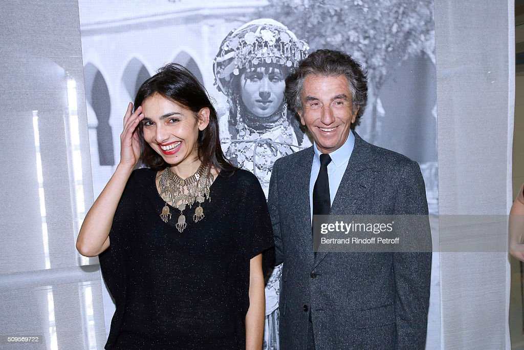 Granddaughter of Django Reinhardt, Pianist Charlotte Reinhardt, wearing jewelry of the collection and President of the 'Institut du Monde Arabe' <a gi-track='captionPersonalityLinkClicked' href=/galleries/search?phrase=Jack+Lang&family=editorial&specificpeople=220296 ng-click='$event.stopPropagation()'>Jack Lang</a> attend the Opening of the Exhibition 'Tresors à porter', Treasures to wear, presented in the Museum of the 'Institut du Monde Arabe' on February 11, 2016 in Paris, France.