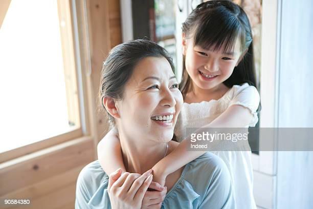 Granddaughter smiling behind grandmother