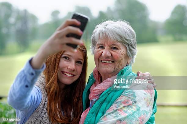 Granddaughter taking selfie of grandmother and herself