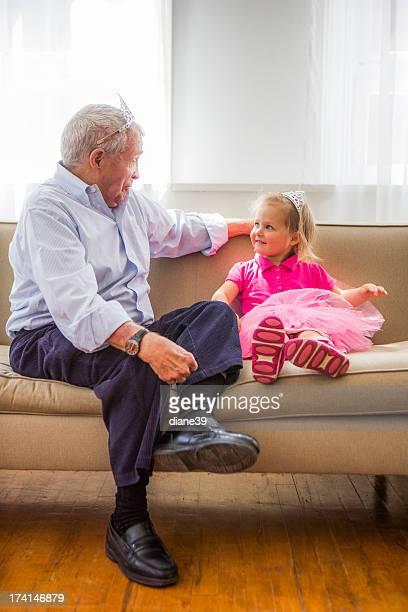 Grandfather and grandaughter playing Princess